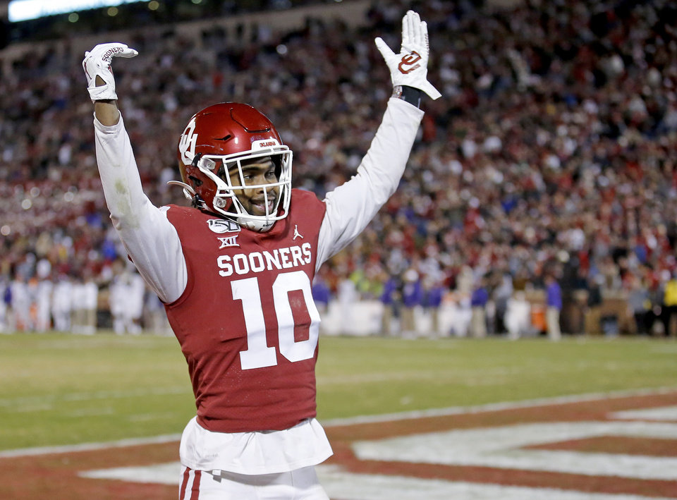 Photo - Oklahoma's Pat Fields (10) celebrates an Oklahoma interception late in the fourth quarter during an NCAA football game between the University of Oklahoma Sooners (OU) and the TCU Horned Frogs at Gaylord Family-Oklahoma Memorial Stadium in Norman, Okla., Saturday, Nov. 23, 2019. OU won 28-24. [Sarah Phipps/The Oklahoman]