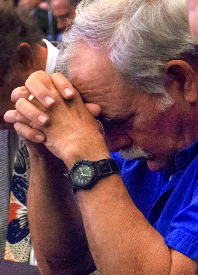 Photo - Carl Mears lowers his head in prayer during the CBMC Metro Prayer Breakfast at the Cox Convention Center in Oklahoma City, Okla. on Tuesday, April 16, 2019.   Photo by Chris Landsberger, The Oklahoman