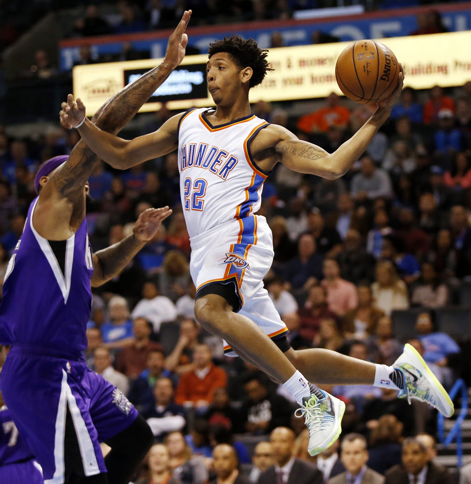 Photo -  Oklahoma City's Cameron Payne (22) passes away from Sacramento's DeMarcus Cousins (15) during an NBA basketball game between the Oklahoma City Thunder and the Sacramento Kings at Chesapeake Energy Arena in Oklahoma City, Monday, Jan. 4, 2016. Photo by Nate Billings, The Oklahoman