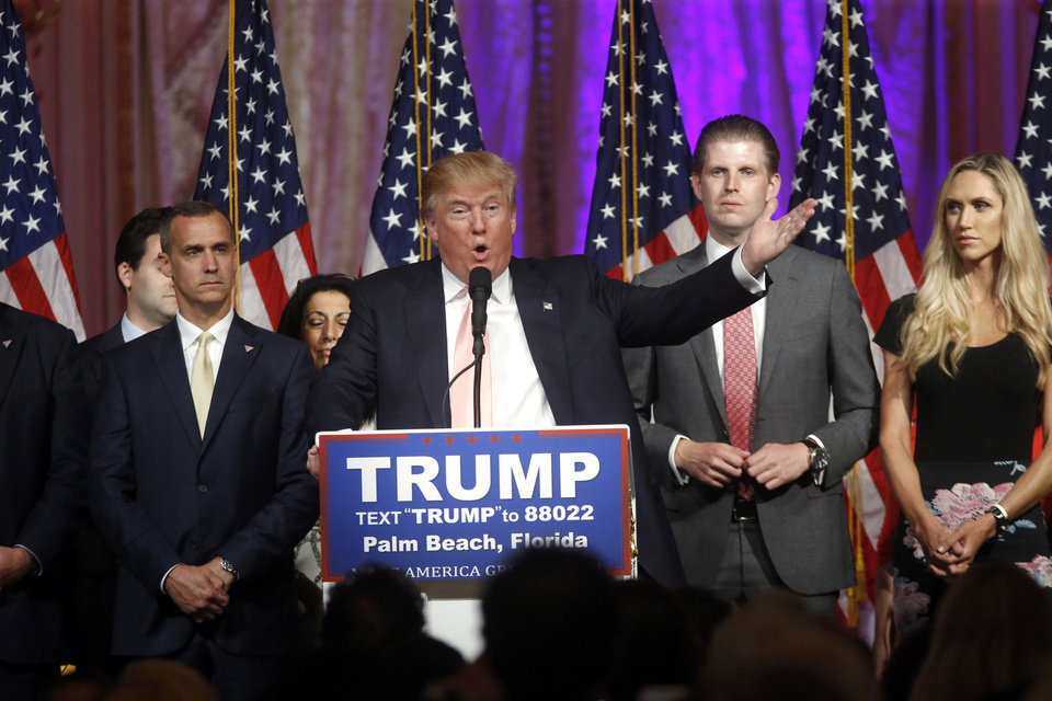 Photo - Republican presidential candidate Donald Trump speaks to supporters at his primary election night event at his Mar-a-Lago Club in Palm Beach, Fla., Tuesday, March 15, 2016. At right is his son Eric Trump and at left is his campaign manager Corey Lewandowski. (AP Photo/Gerald Herbert)