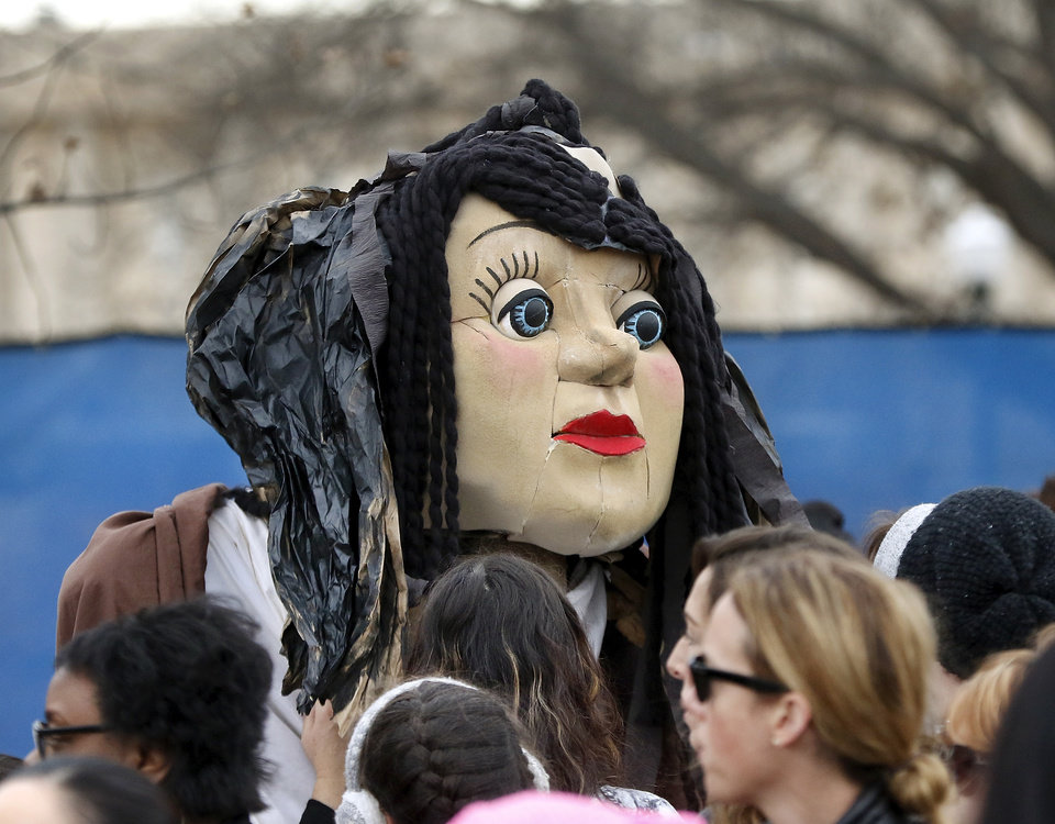 "Photo - A ""face"" at Saturday's rally. A crowd estimated by organizers to be as many as 7,000 people came to the state Capitol in Oklahoma City Saturday, Jan. 21, 2017, to rally, using their voices and signs to express displeasure with the nation's new administration as part of a larger network of marches taking place across the country following Donald Trump's inauguration.   The Women's March on Oklahoma included a walk along Lincoln Blvd., with the Capitol as a backdrop, and a rally on the Capitol's south plaza that featured nearly a dozen speakers.  Photo by Jim Beckel, The Oklahoman"