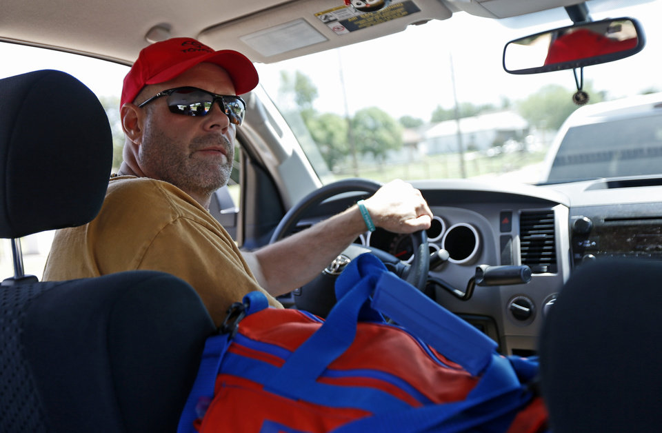 Photo - Southgate Baptist Church volunteer  Larry Sullivan drives a truck carrying water and Mercy Chefs meals to tornado victims in Moore, Okla., Wednesday, May 22, 2013. A tornado damaged the area on Monday, May 20, 2013. Photo by Bryan Terry, The Oklahoman