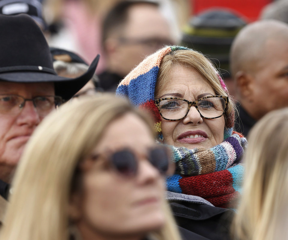 Photo - People in the crowd dressed for cold temperatures when they attended outdoor inauguration ceremony for Kevin Stitt who was sworn in as Oklahoma's 28th governor by Supreme Court Chief Justice Noma Gurich on Monday, Jan. 14, 2019. Photo by Jim Beckel, The Oklahoman.