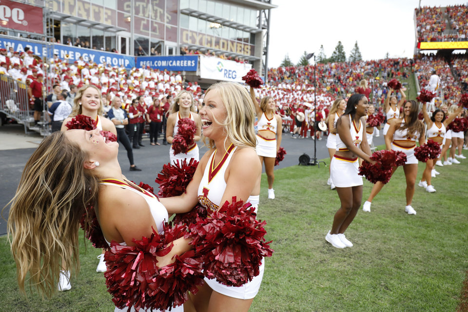Photo - Iowa State cheerleaders celebrate a touchdown during the second overtime of an NCAA college football game against Northern Iowa, Saturday, Aug. 31, 2019, in Ames, Iowa. (AP Photo/Matthew Putney)