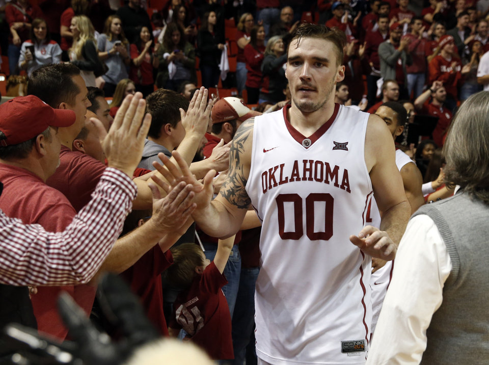 Photo - Oklahoma's Ryan Spangler (00) leaves the court as the University of Oklahoma Sooner (OU) men defeat the West Virginia Mountaineers (WV) 70-68 in NCAA, college basketball at The Lloyd Noble Center on Jan. 16, 2016 in Norman, Okla. Photo by Steve Sisney, The Oklahoman