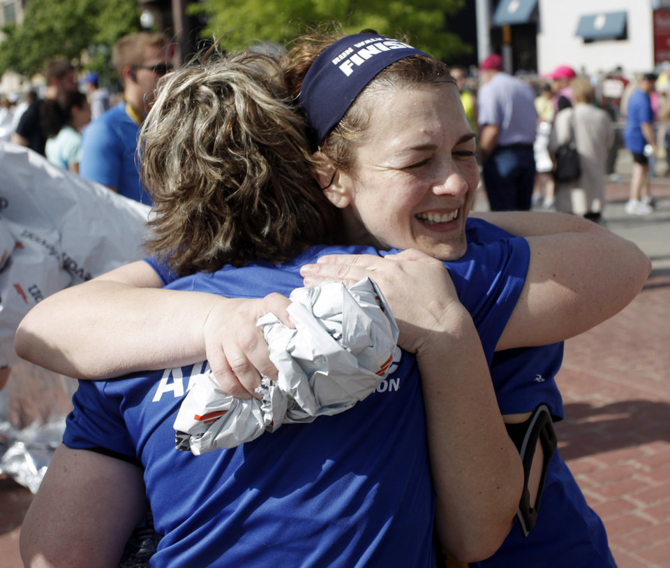 Photo - ALFRED P. MURRAH FEDERAL BUILDING BOMBING SURVIVOR: Allegiance Credit Union runner Terri Talley hugs Amy Petty after the half marathon during the 10th anniversary of the Oklahoma City Memorial Marathon Sunday, April 25, 2010 in Oklahoma City. Talley and Petty were injured during the bombing fifteen years ago. Photo by Doug Hoke, The Oklahoman. ORG XMIT: KOD