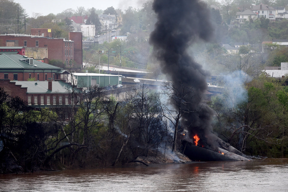 Photo -  Nearby buildings were evacuated in Lynchburg, Va., but city officials said there were no injuries Wednesday after a CSX train with tanker cars carrying crude oil derailed and burned near downtown. AP Photo   Parker Michels-boyce -