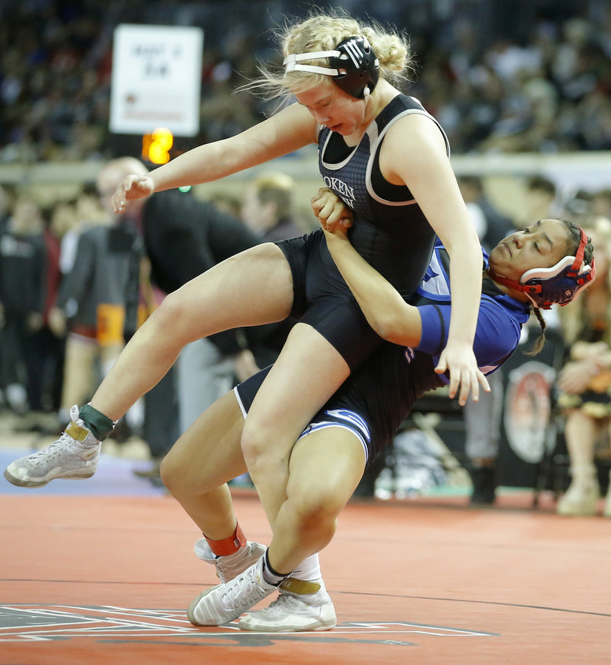 Photo - Broken Arrow's Allison Hynes, top, wrestles Guthrie's Khaleah Kirk during the 118-pound state tournament title match Saturday at State Fair Arena. [Bryan Terry/The Oklahoman]