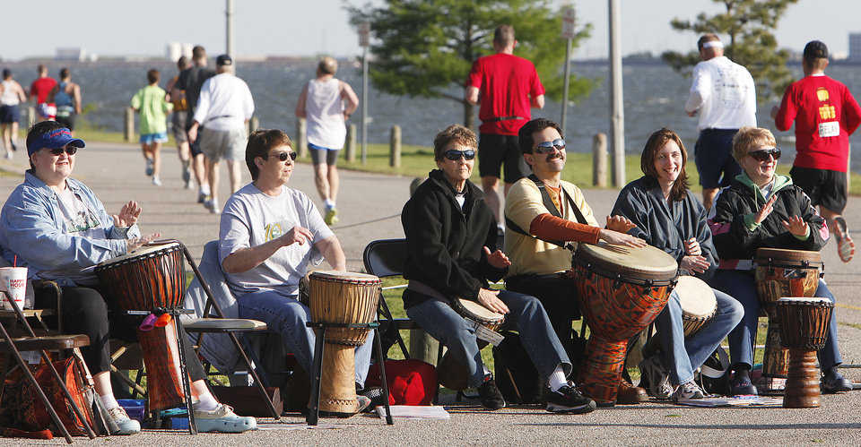 Photo - MUSIC: Members of Bantaba play drums for the runners as they pass through  Stars and Stripes Park during the Tenth Annual Oklahoma City Memorial Marathon, Sunday, April 25, 2010.   Photo by David McDaniel, The Oklahoman ORG XMIT: KOD