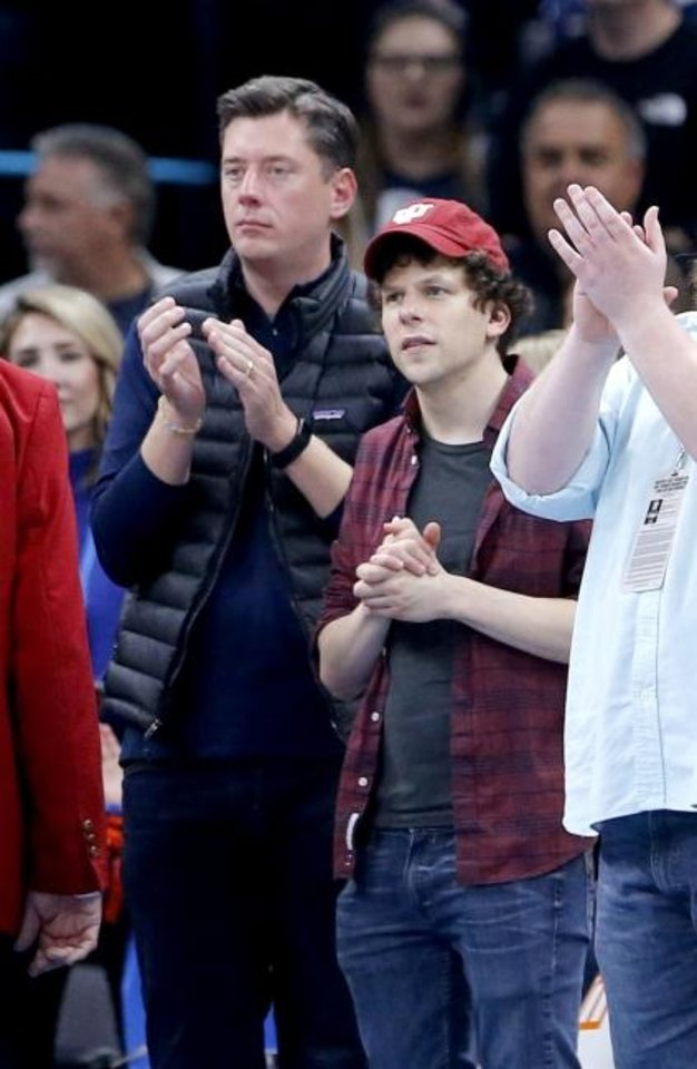 Photo -  Oklahoma City Mayor David Holt watches the game with actor Jesse Eisenberg during the NBA game between the Oklahoma City Thunder and the Milwaukee Bucks at Chesapeake Energy Arena, Sunday, Nov. 10, 2019. The Oscar-nominated actor was in Oklahoma working on the film