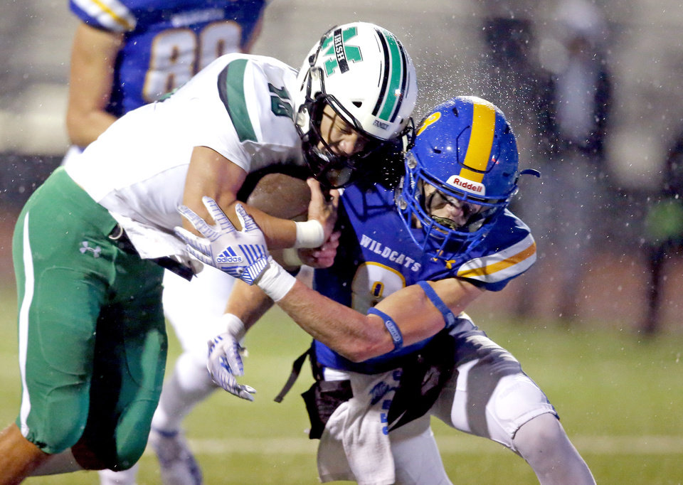 Photo - Bishop McGuinness's Luke Tarman is tackled by Piedmont's Caden Hendren during the high school football game between Piedmont and Bishop McGuinness at Piedmont High School in Piedmont, Okla.,  Friday, Oct. 25, 2019. [Sarah Phipps/The Oklahoman]