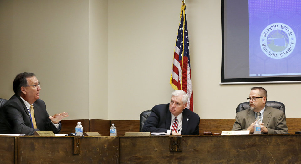 Photo - From left, Charles E. Skillings, Tom Bates and Timothy Starkey, board president. Bates is interim commissioner for the Oklahoma Department of Health. The Oklahoma State Department of Health voted at their monthly meeting Tuesday morning, July 10, 2018, to ban sales of smokeable forms of medical marijuana and to require dispensaries to hire a pharmacist. The Board of Health voted on 75 pages of rules creating a rough framework for patients, physicians, caretakers and business owners interested in medical marijuana. The ban on sales of leaves and flowers for smoking and the requirement to hire a pharmacist weren't in the draft rules presented to the board, but were a priority of a coalition of medical groups. Julie Ezell, the Health Department's general counsel, presented the rules to a packed board room and to members of the public watching in an overflow room and online. She cautioned board members that the two new rules they added might not be allowed under the state question, inviting a court challenge. Photo by Jim Beckel, The Oklahoman
