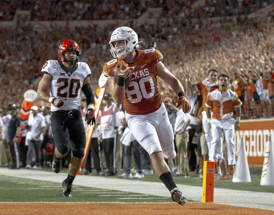 Photo - Texas tight end Cade Brewer (80) scores a touchdown after catching a pass against Oklahoma State during an NCAA college football game Saturday, Sept. 21, 2019, in Austin, Texas. (Nick Wagner/Austin American-Statesman via AP)
