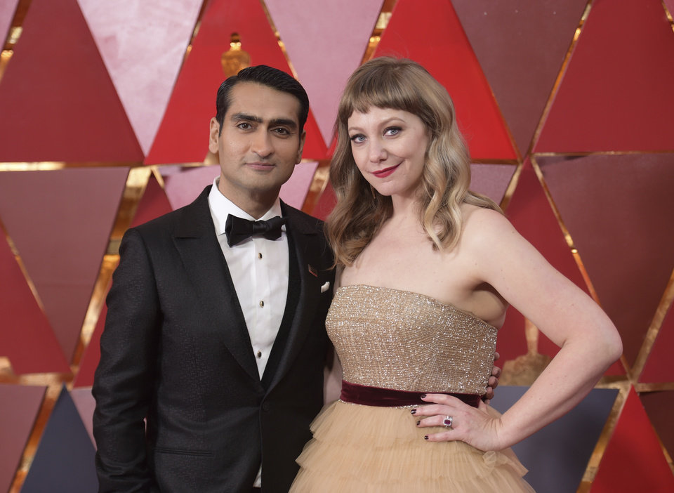 Photo - Kumail Nanjiani, left, and Emily V. Gordon arrive at the Oscars on Sunday, March 4, 2018, at the Dolby Theatre in Los Angeles. (Photo by Richard Shotwell/Invision/AP)