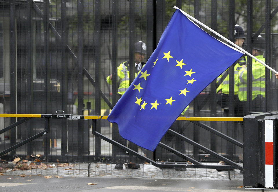 Photo -  A European Union flag is flown in front of entrance gates to Parliament in London, Monday, Sept. 9, 2019. British Prime Minister Boris Johnson voiced optimism Monday that a new Brexit deal can be reached so Britain leaves the European Union by Oct. 31. (AP Photo/Kirsty Wigglesworth)