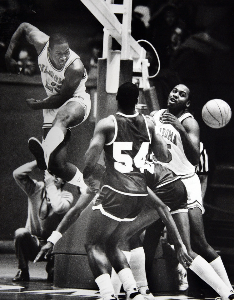 Photo - Former OU basketball player Wayman Tisdale. OU's Wayman Tisdale (31 points) emphatically swats away a shot by Jerome Baptiste as Sooner David Johnson (19 rebounds) and Ronald Cox (54) of McNeese State look on. Staff photo by Doug Hoke. Phtoo taken 1/4/1984, Photo published 1/5/1984 in The Daily Oklahoman. ORG XMIT: KOD