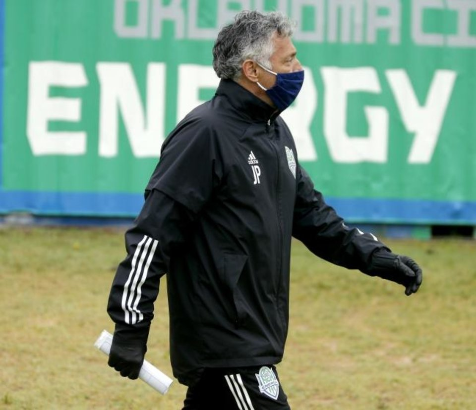 Photo -  Energy FC coach John Pascarella arrives for soccer practice on Wednesday. [Bryan Terry/The Oklahoman]