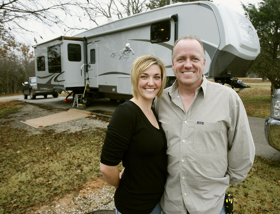 Photo - RICHARD BERCHER: Richard and Michelle Bercher have sold their home and are living in a fifth-wheel at Arcadia Lake in Edmond, OK, Saturday, Nov. 21, 2009. They are downsizing getting ready for their retirement years when they plan to travel. By Paul Hellstern, The Oklahoman ORG XMIT: KOD