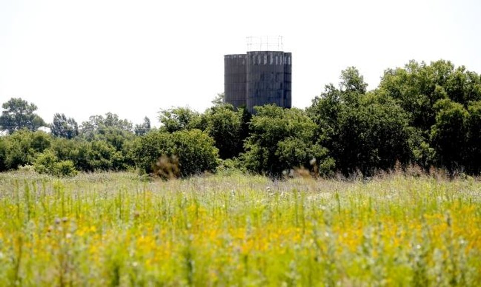 Photo -  Old silos are pictured near at a new housing development in northwest Oklahoma City at NW 150 and Council Road.