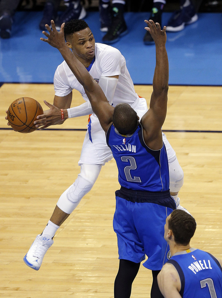 Photo - Oklahoma City's Russell Westbrook (0) passes the ball around Dallas' Raymond Felton (2) during Game 2 in the first round of the NBA playoffs between the Oklahoma City Thunder and the Dallas Mavericks at Chesapeake Energy Arena in Oklahoma City, Monday, April 18, 2016. Photo by Sarah Phipps, The Oklahoman