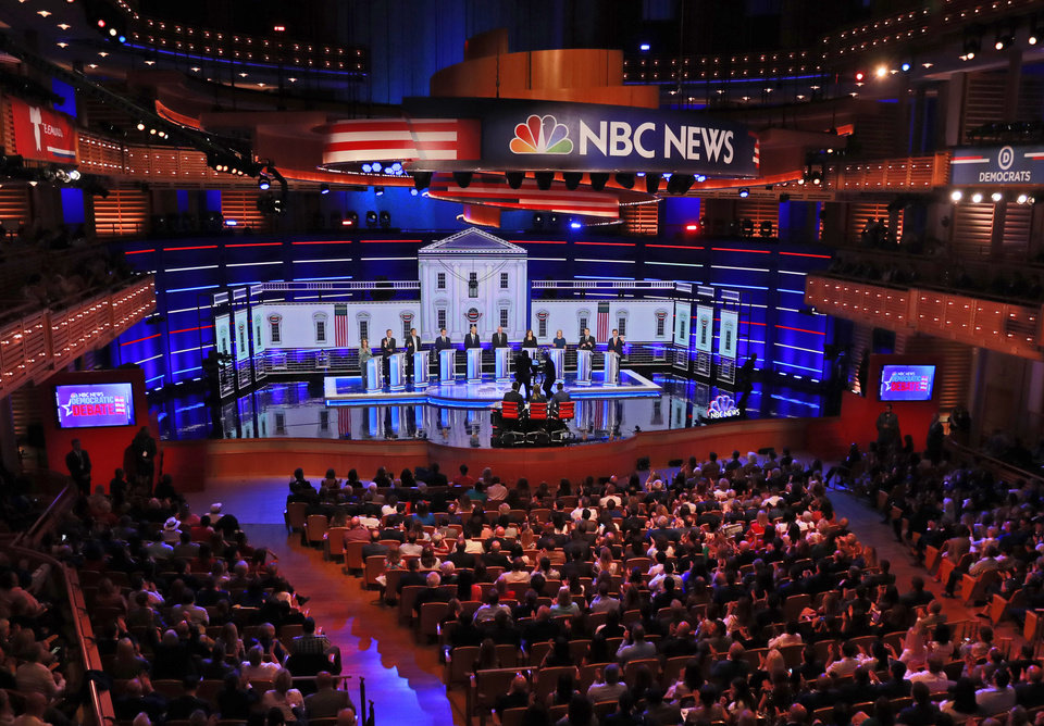 Photo - Democratic presidential candidates, author Marianne Williamson, former Colorado Gov. John Hickenlooper, entrepreneur Andrew Yang, South Bend Mayor Pete Buttigieg, former Vice President Joe Biden, Sen. Bernie Sanders, I-Vt., Sen. Kamala Harris, D-Calif., Sen. Kirsten Gillibrand, D-N.Y., former Colorado Sen. Michael Bennet, and Rep. Eric Swalwell, D-Calif., listen to a question during a Democratic primary debate hosted by NBC News at the Adrienne Arsht Center for the Performing Arts, Thursday, June 27, 2019, in Miami. (AP Photo/Wilfredo Lee)