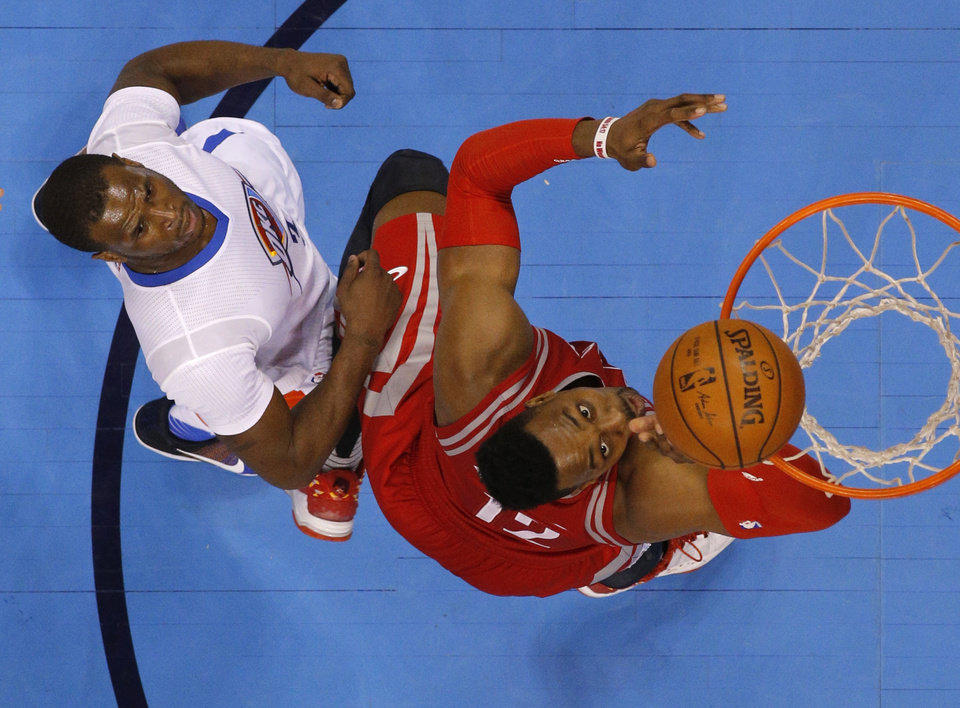 Photo - Houston's Dwight Howard (12) makes a basket in front of Oklahoma City's Dion Waiters (3) during an NBA basketball game between the Oklahoma City Thunder and the Houston Rockets at Chesapeake Energy Arena in Oklahoma City, Tuesday, March 22, 2016. Oklahoma City won 111-107. Photo by Bryan Terry, The Oklahoman