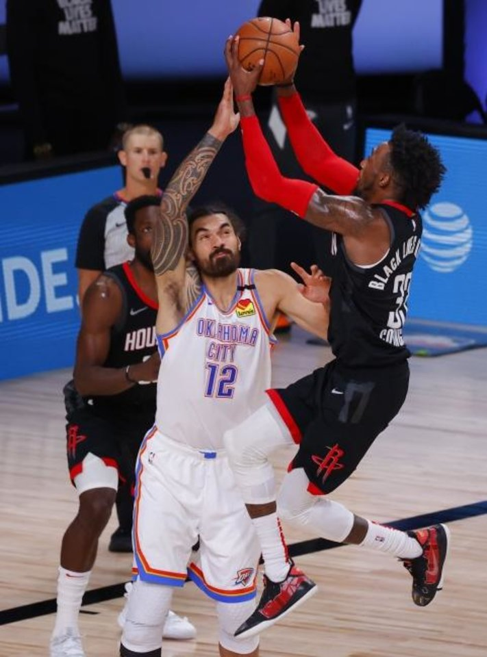 Photo -  Houston's Robert Covington (33) goes up to shoot against Oklahoma City's Steven Adams (12) during the fourth quarter of Game 4 Monday. [Kevin C. Cox/Pool Photo via AP]