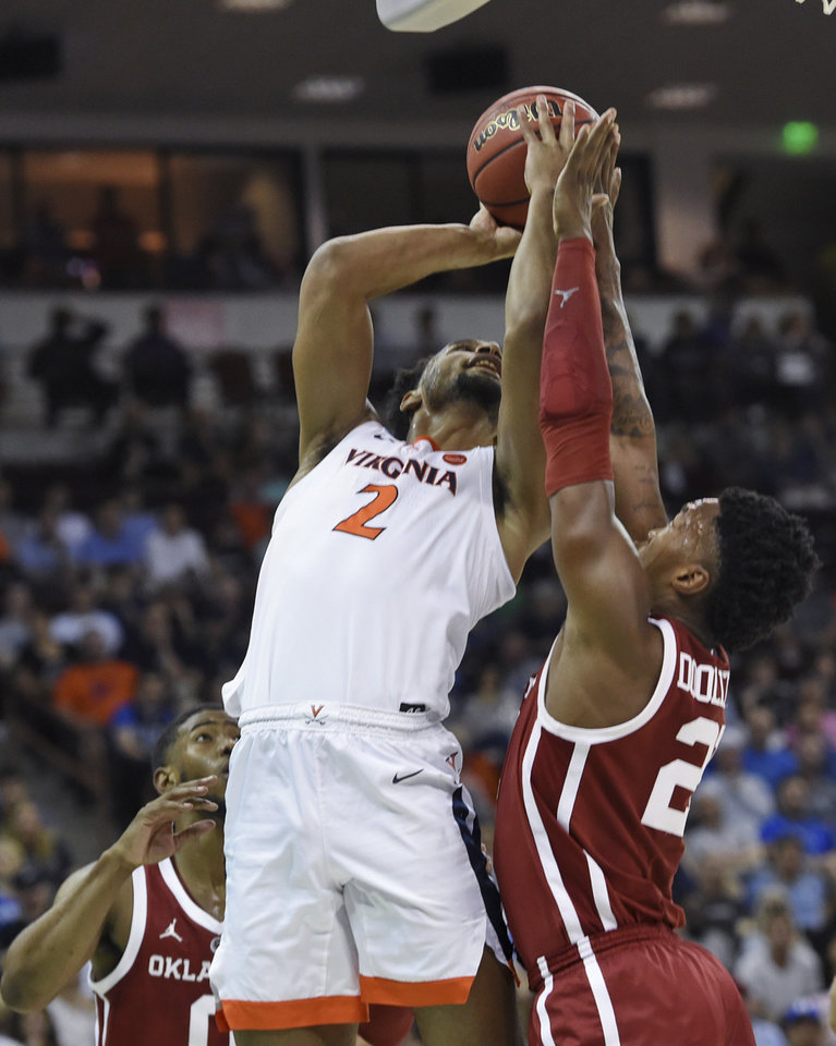 Photo - Virginia's Braxton Key (2) attempts to shoot over Oklahoma's Kristian Doolittle (21) during the second half of a second-round men's college basketball game in the NCAA Tournament in Columbia, S.C., Sunday, March 24, 2019. (AP Photo/Richard Shiro)