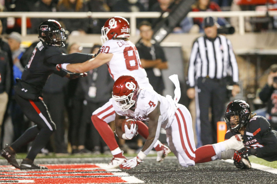 Photo - Oklahoma Sooners running back Trey Sermon (4)  gets tackled in the end zone by Texas Tech Red Raiders defensive back John Bonney (10) during the NCAA football game between the Texas Tech Red Raiders and the Oklahoma Sooners at Jones AT&T Stadium in Lubbock, Texas on Saturday, November 03, 2018. IAN MAULE/Tulsa World