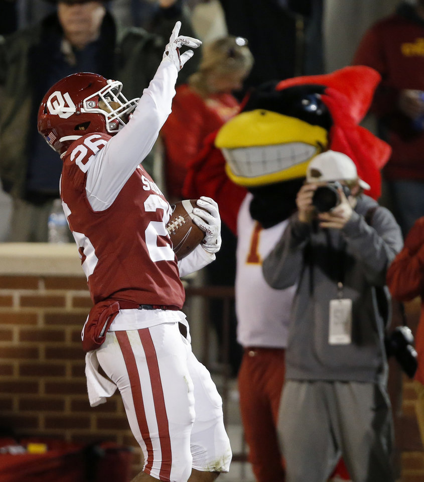 Photo - Oklahoma's Kennedy Brooks (26) celebrates after scoring a touchdown during an NCAA football game between the University of Oklahoma Sooners (OU) and the Iowa State University Cyclones at Gaylord Family-Oklahoma Memorial Stadium in Norman, Okla., Saturday, Nov. 9, 2019. [Bryan Terry/The Oklahoman]
