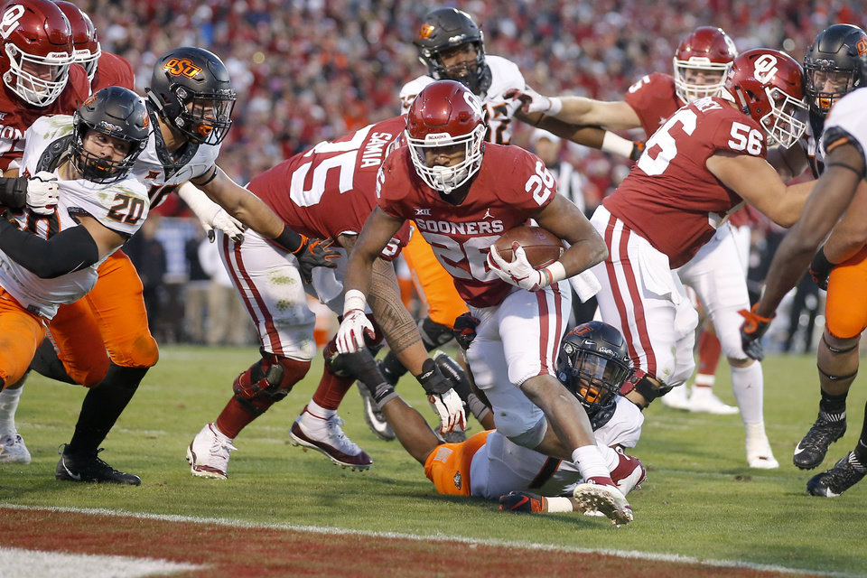 Photo - Oklahoma's Kennedy Brooks (26) scores a touchdown during a Bedlam college football game between the University of Oklahoma Sooners (OU) and the Oklahoma State University Cowboys (OSU) at Gaylord Family-Oklahoma Memorial Stadium in Norman, Okla., Nov. 10, 2018.  Photo by Bryan Terry, The Oklahoman
