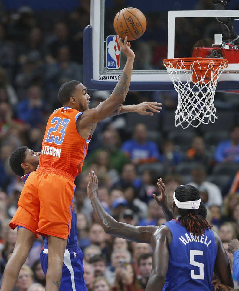 Photo - Oklahoma City's Terrance Ferguson (23) taps the ball back out beside LA's Paul George (13) during an NBA basketball game between the Oklahoma City Thunder and the LA Clippers at Chesapeake Energy Arena in Oklahoma City, Sunday, Dec. 22, 2019. Oklahoma City won 118-112. [Bryan Terry/The Oklahoman]