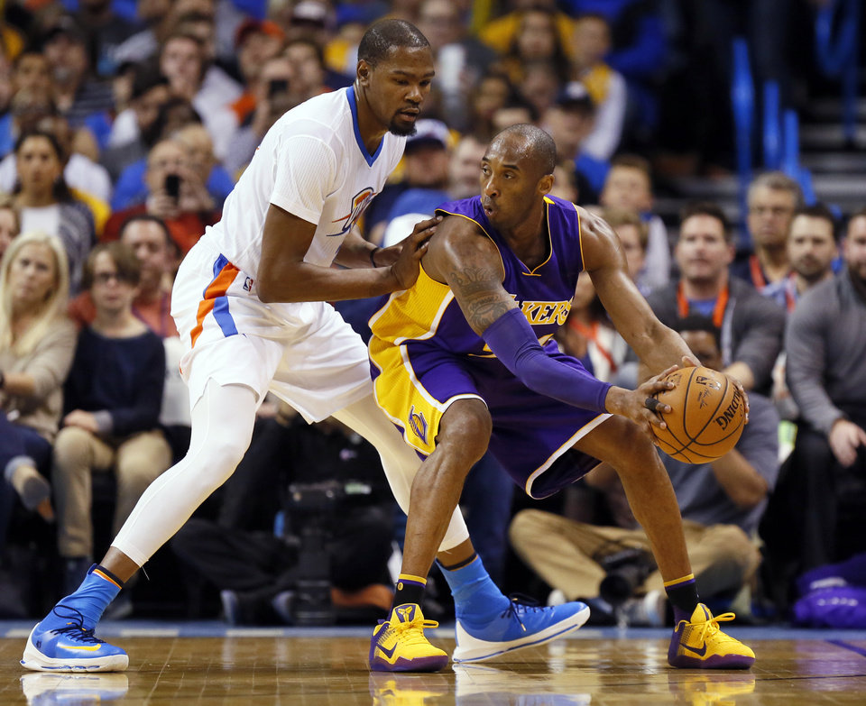 Photo - Los Angeles' Kobe Bryant (24) works against Oklahoma City's Kevin Durant (35) during an NBA basketball game between the Oklahoma City Thunder and the Los Angeles Lakers at Chesapeake Energy Arena in Oklahoma City, Monday, April 11, 2016. Photo by Nate Billings, The Oklahoman