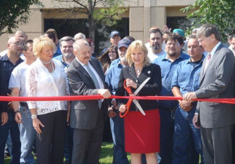 Photo - Gov. Mary Fallin at a ribbon cutting ceremony at UE Manufacturing in Oklahoma City.   - PROVIDED