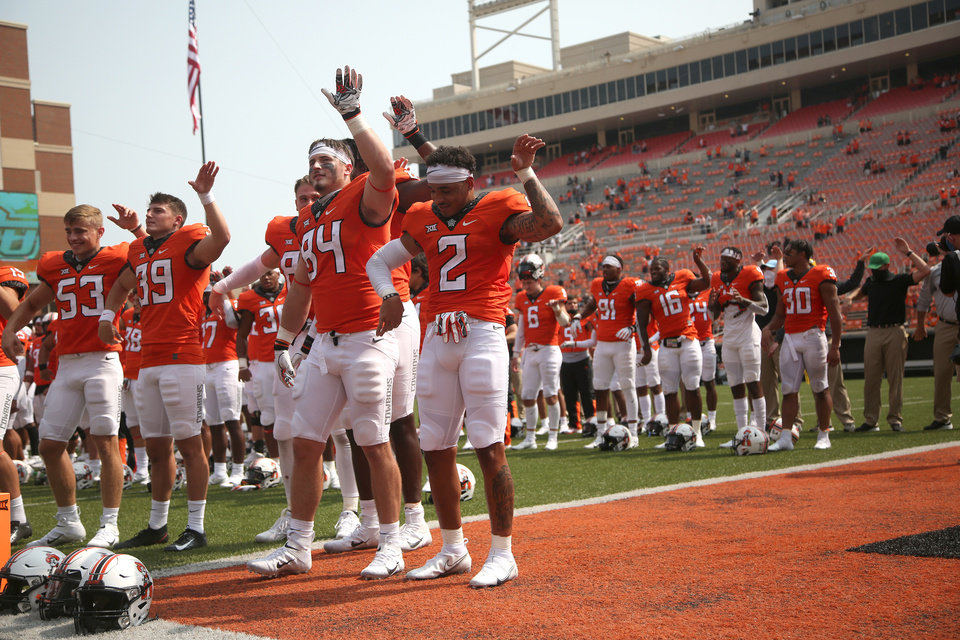 Photo - Oklahoma State's Tylan Wallace (#2) and his teammates gather for the alma mater after beating Tulsa during their first game of the season at Boone Pickens Stadium in Stillwater on Saturday, September 19, 2020. OSU won the game 16-7. JOHN CLANTON, TULSA WORLD