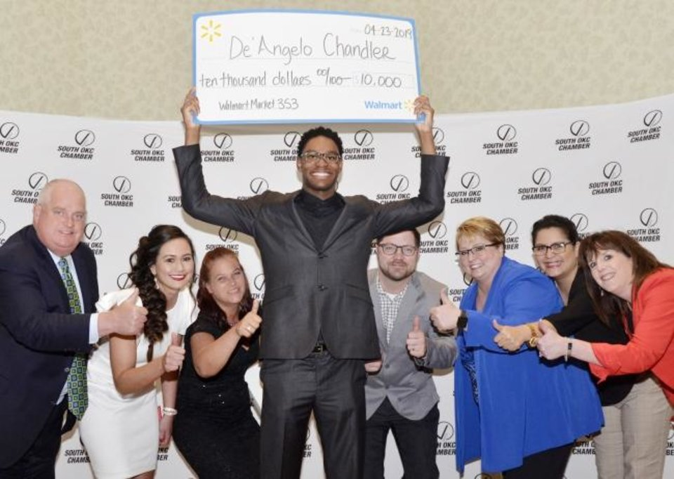 Photo -  De'Angelo Chandler, center, of Southeast High School, was recently named Student of the Year during the South Oklahoma City Chamber's Excellence in Education Banquet. Pictured with Chandler are, from left, Chris Wainwright, Michelle Kent, Annette Holt, Kyle Weaver, Mylissa Hall, Gloria Torres and Elaine Lyons. [PHOTO PROVIDED]
