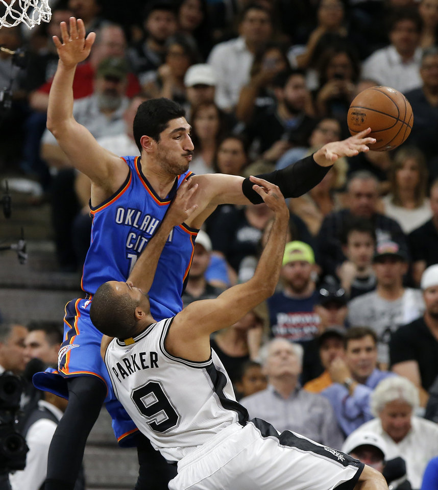 Photo - Oklahoma City's Enes Kanter (11) defends San Antonio's Tony Parker (9) during Game 5 of the second-round series between the Oklahoma City Thunder and the San Antonio Spurs in the NBA playoffs at the AT&T Center in San Antonio, Tuesday, May 10, 2016. Photo by Bryan Terry, The Oklahoman