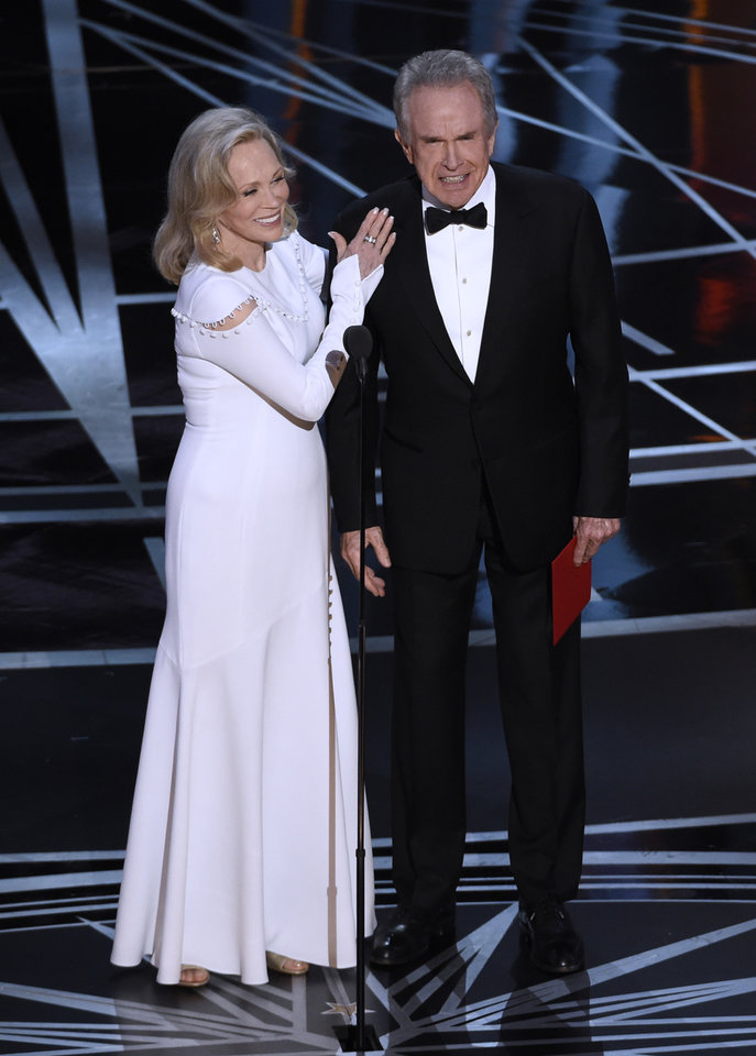 Photo - Faye Dunaway, left, and Warren Beatty present the award for best picture at the Oscars on Sunday, Feb. 26, 2017, at the Dolby Theatre in Los Angeles. (Photo by Chris Pizzello/Invision/AP)