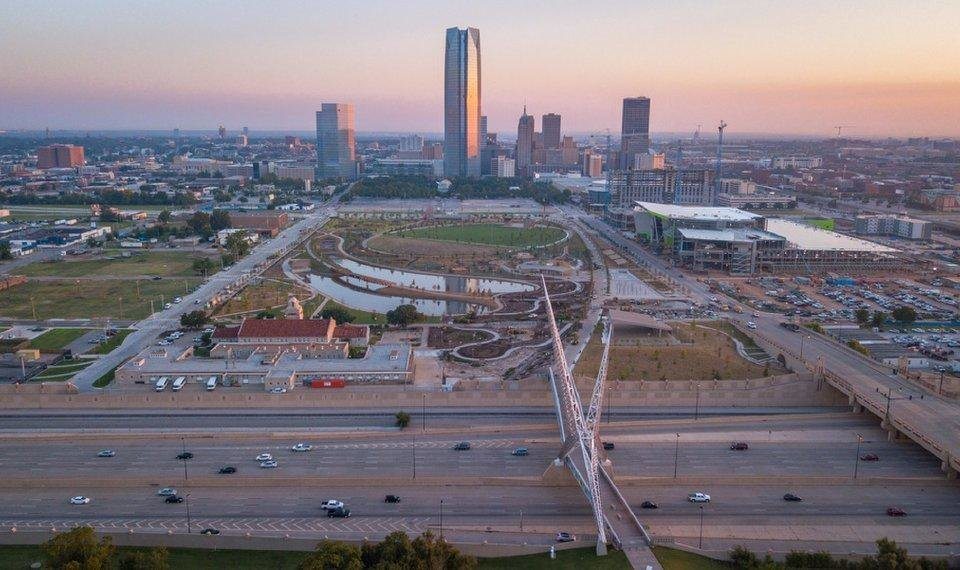 Photo - Drone image of Skydance Bridge, Scissortail Park, downtown OKC skyline, and construction of Omni Hotel and future convention center. Looking north from just south of I-40, just west of Robinson. Image by Dave Morris.
