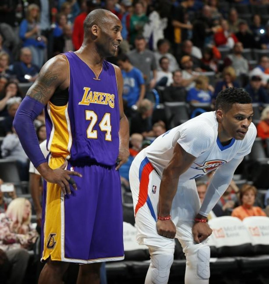 Photo -  Los Angeles' Kobe Bryant, left, talks to Oklahoma City's Russell Westbrook during an April 2016 game at Chesapeake Energy Arena. [Nate Billings/The Oklahoman]