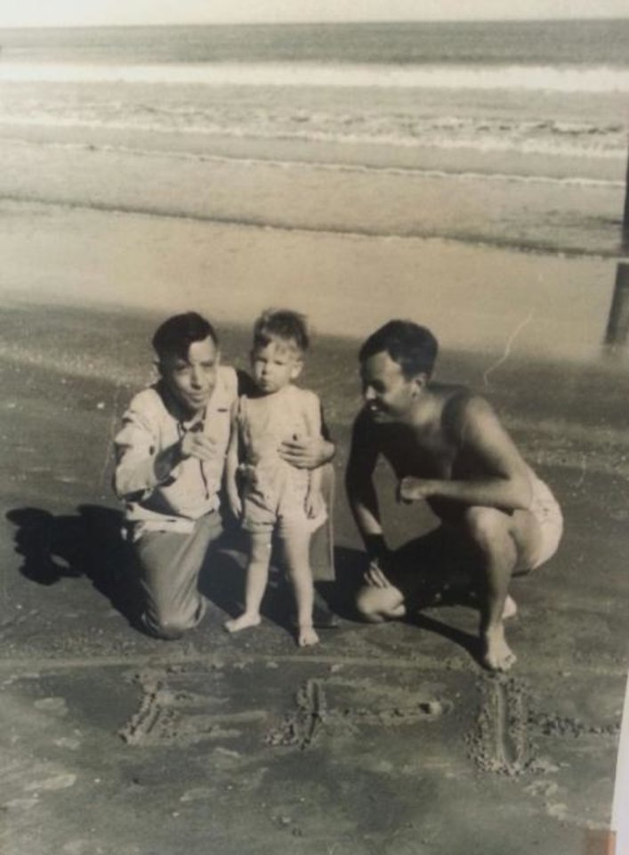 Photo -  Erle P. Halliburton and his son pose for a beach photo with EP 3. [PROVIDED BY STEPHENS COUNTY HISTORICAL SOCIETY]