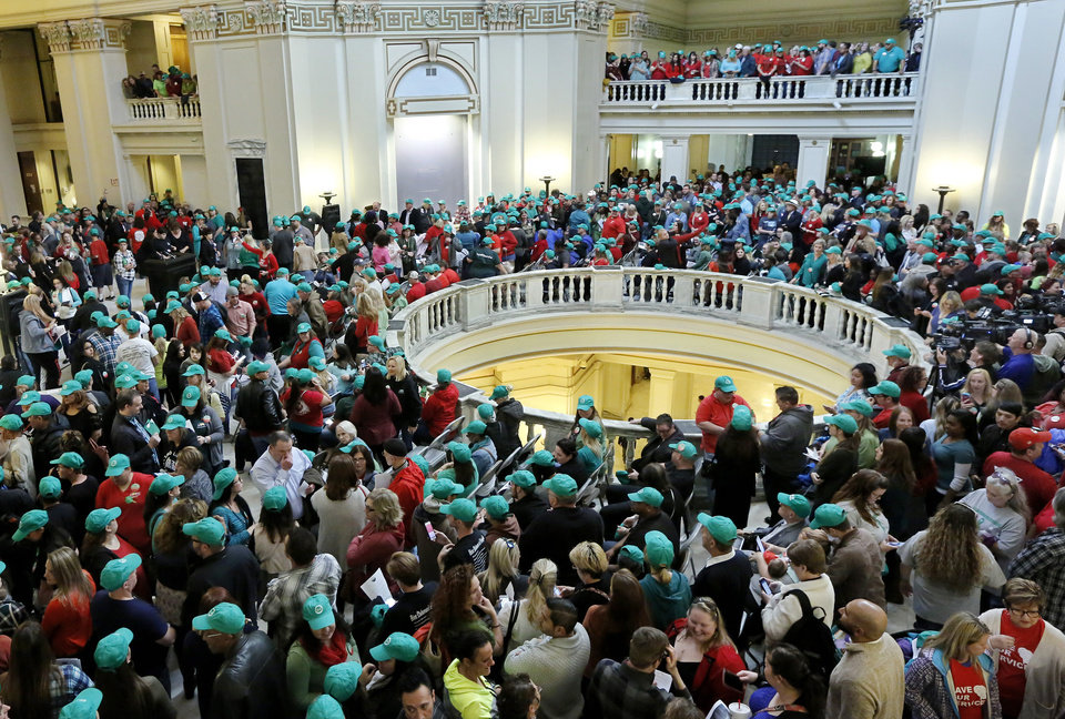 Photo -  The fourth-floor rotunda is filled to capacity with rally participants. Others stand on the fifth floor to hear speakers. Advocates for mental health care descended upon the state Capitol on Tuesday morning to demand that lawmakers come up with a budget solution that includes funding for mental health services. [Photo by Jim Beckel, The Oklahoman]