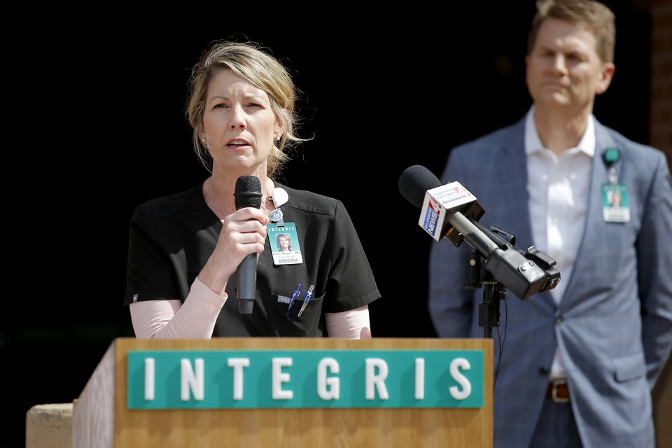 Photo - Integris Executive Vice President and Chief Nurse Executive Kerri Bayer speaks during a COVID-19 press conference in front of Integris Baptist Medical Center in Oklahoma City, Wednesday, March 18, 2020. [Bryan Terry/The Oklahoman]