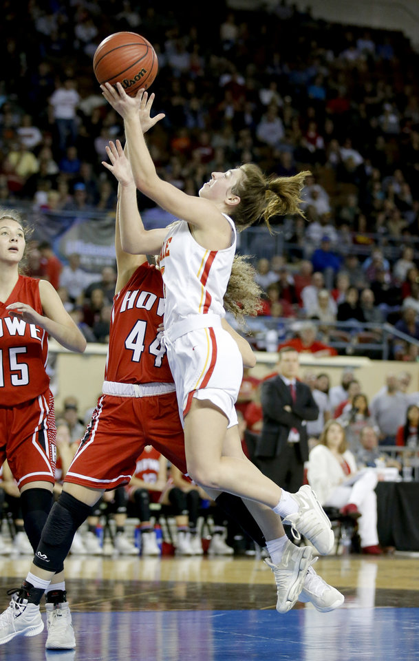 Photo - Dale's Lindy Nowakowski goes up for a lay up as Howe's Zoe Nation defends during the 2A girls state high school basketball championship at Jim Norick State Fair Arena, the Big House, at State Fair Park in Oklahoma City,  Saturday, March 9, 2019. Photo by Sarah Phipps, The Oklahoman