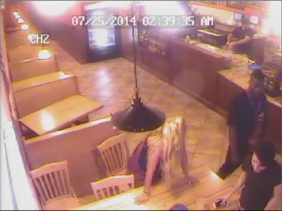 Photo - This screengrab from the Pickleman's Cafe surveillance video shows Joe Mixon at right and Amelia Molitor at left.