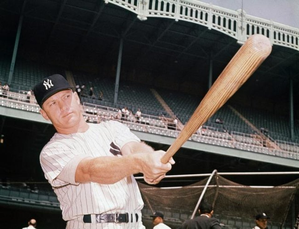 Photo -  Mickey Mantle, pictured in 1961 during his Hall of Fame career with the New York Yankees, would have turned 89 years old last week. [AP FILE PHOTO]