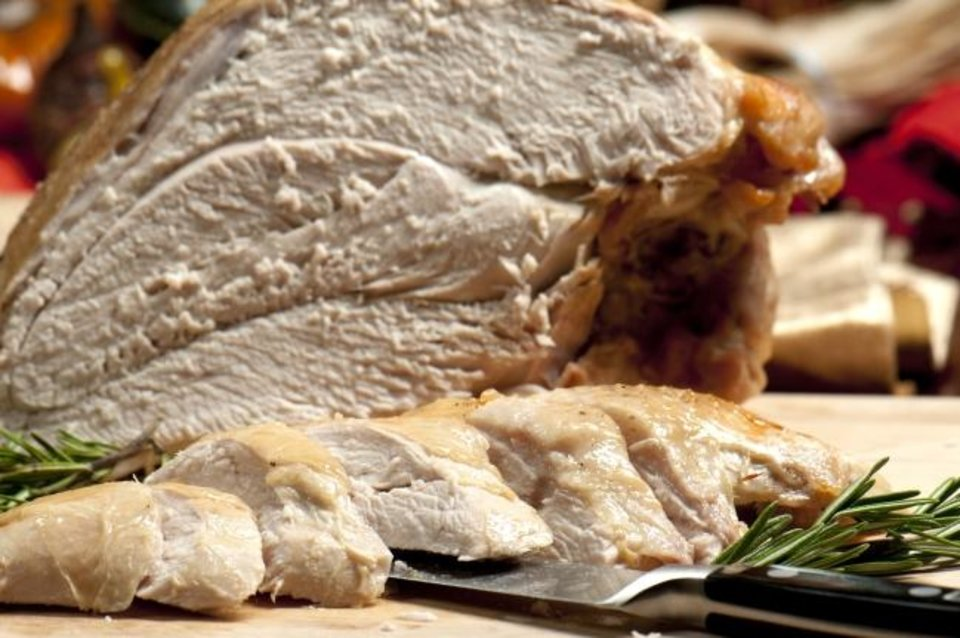 Photo -  If you've decided that a turkey breast is the way to go, there are tips for cooking that specific part of the bird, one that tends to dry out more than others. [Metro Creative Connection]