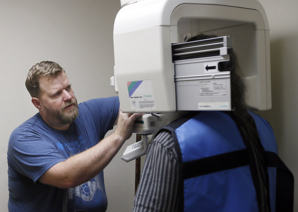 Photo -  Laban Jones takes X-rays of a patient at the Open Wide Dental Clinic at Portland Avenue Baptist Church. [Photo by Nate Billings, The Oklahoman]