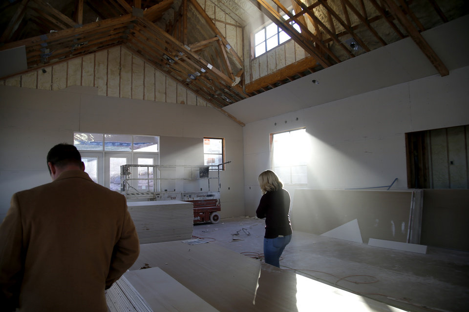 Photo -  People walk through the meeting house at The Prairie at Post addition in Edmond. [PHOTO BY BRYAN TERRY, THE OKLAHOMAN]