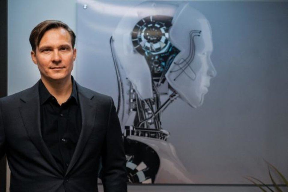 Photo -  Human Mode founder and CEO William X. Kerber poses in his Oklahoma City office. Human Mode has released its first virtual reality game, Stratoscape, but is also researching artificial intelligence and robotics. [Provided]